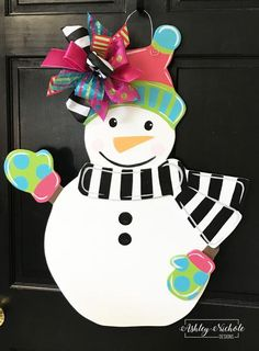 This snowman is a bright and happy piece. Hang him during the holidays or all winter long! Dimensions: 28 Tall x 24 wide Christmas Door, Christmas Wreaths, Christmas Crafts, Christmas Decorations, Christmas Ornaments, Holiday Decor, Christmas Plaques, Xmas, Wooden Ornaments