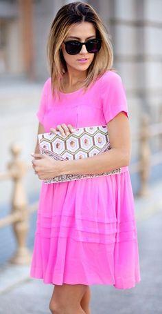 Neon pink shift dress.