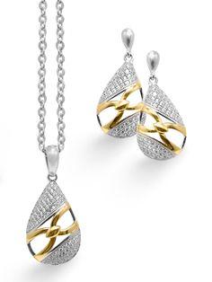 Elegante diseño para esta #joya de #vanguardia, es un conjunto de #pendientes y #gargantilla en #plata con un baño de #oro.