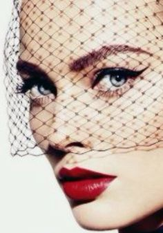 Classic Red Lips,  Black Eyeliner, and Black Netting Veil, editorial makeup. via Vanity Fair, September 2013, Margot Robbie, Miguel Reveriego.