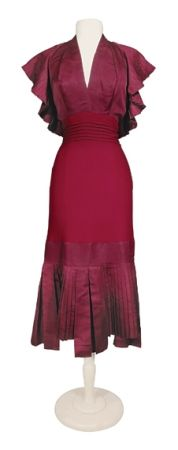 1940s Maroon Halter Day Dress  American. The bodice of faille with fan pleated ruffle descending from shoulders around to low U back, slender crepe skirt with faille fan and box pleated deep hem, tucked stitched waistband, labeled: Adrian Original.