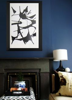 A large frame left behind by her home's previous owners inspired Megan to DIY some art for her home. She used a spin toy that her kids used to make T-shirts to create a graphic and modern Rorschach-like abstract work.