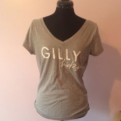 Cute Top Grey with white lettering. Pre owned and loved. No flaws I can see Gilly Hicks Tops