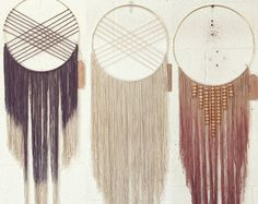 This is a large alterna dream catcher featuring walnut colored wooden beads and an ombre tan- mauve fiber piece. It is largely inspired by a desert