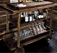 Bar Cart No. One ($2,500) - custom handmade in New England features a built-in ice bucket that stands flush with the surface of the bar—perfect for mixing and serving.