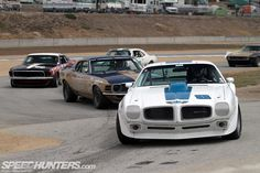 TRANS AM RACING and no im not talking about the pontiac in the foreground