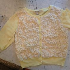 Forever 21 Embroidered Sweater Adorable lemon colored embroidered sweater with daisy-like flowers in cream from Forever 21.  Size small but fits like an XS or size 0. Gently worn.  100% cotton.  Hand wash cold. Dry flat. No trades or Paypal please. Forever 21 Sweaters