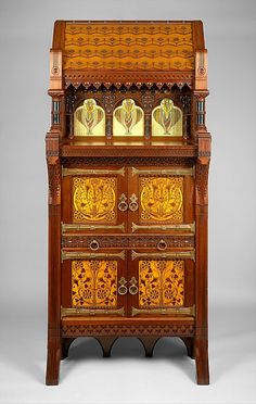 Cabinet Made Of Walnut, Maple, White Pine And Glass And Attributed To Daniel Pabst (1826-1910) - American   c 1877-1880