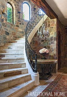 Put closet under stairs, create new wall The turret displays arched windows and a curved stone staircase that leads up to second-story bedrooms and down to a wine cellar and tasting room. Rustic Italian, Italian Home, Italian Farmhouse, Staircase Railing Design, Curved Staircase, Tuscan House, Tuscan Decorating, Interior Decorating, Arched Windows