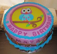Owl Birthday Cake - Cake for a little girl's 2nd birthday.  Mom sent me the design of the decorations and wanted the cake to be the same.  She was very happy with it.