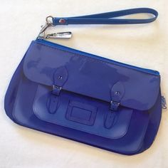 HP Catseye London trompe l'oeil wristlet SO CUTE! Shiny blue wristlet with bookbag graphics printed on each side! Zip closure with wrist strap. Simple and super fun--and big enough to hold my iPhone 6! NWOT; never used. Catseye London Bags Clutches & Wristlets