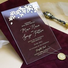 These luxurious acrylic wedding invitations feature a sparkling foil-stamped foliage tracery that along with contemporary calligraphy endows the design with a stylish and modern look. The invitations are accompanied with opulent burgundy velvet envelopes. The envelopes are sealed with gold wax seals and tied with gold string.   Marriage Invitation Card, Indian Wedding Invitation Cards, Wedding Invitation Card Design, Wedding Cards, Acrylic Wedding Invitations, Burgundy Wedding Invitations, Creative Wedding Invitations, Wedding Card Design Indian, Velvet Wedding Stationery