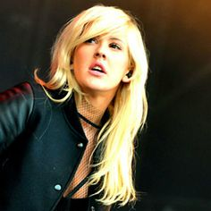 'I used to be obsessed with Pearl Jam, but I love having pink hair and kind of looking like a Barbie.' - Ellie Goulding