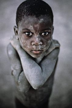 """Steeve McCurry is a universally recognized photojournalist, best known for his photograph, """"Afghan Girl"""" that originally appeared in National Geographic magazine. He travels across the world and takes amazing portraits of people he meets, extracting the powerful feelings they express."""