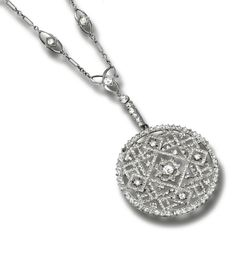 A DIAMOND PENDANT, the circular pendant of openwork design, highlighted at the centre with a Frettée cross, set with circular- and rose-cut diamonds, on a oval link chain set with circular-cut diamonds, length approximately 385mm.