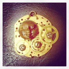 Weeping man on the moon pendant. Antique natural patina on face with old cogs and casing as backdrop. Work in progress... #steampunk #emeraldinceptions