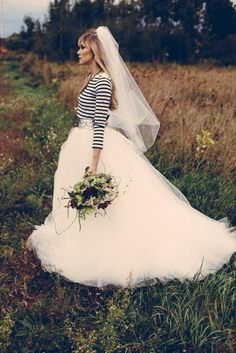 I've just fallen in love with this idea for a wedding dress; pairing something as relaxed as a bateau-necklined striped top with acres of white tulle