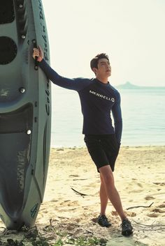 "Model-turned-actor Kim Woo-bin showed off his physique in a recent photo shoot with the global travel magazine ""The Traveler."" Donning a set of rash guards from Murrell, Kim posed in front of the emerald blue waters of Okinawa Island, Japan. Kim Woo Bin, Korean Celebrities, Korean Actors, Celebs, Korean Men, Asian Men, Lee Min Ho, Park Si Hoo, Cute Asian Guys"