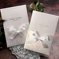 White invitation with ribbon