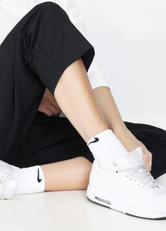 Show off your sporty socks in a cool pair of trainers/sneakers. You can even rock the socks in a pair of Birkenstocks or other chunky sandals with a shirt, pair of shorts or like here with your classic trousers.