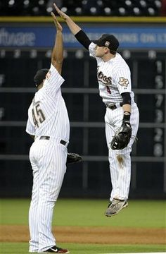 Houston Astros' Carlos Lee (45) and Jed Lowrie (4) celebrate the Astros' 5-3 win over the San Diego Padres in a baseball game Tuesday, June 26, 2012, in Houston. (AP Photo/Pat Sullivan)  game 74