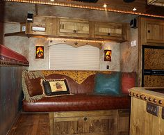 I like the frame over the window and the big nail heads along counter top.  horse trailer..love