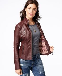 $70 -  Jou Jou's faux leather moto jacket takes your everyday style up a notch and gives you instant rocket edge with its band collar and cool moto jacket accents!      Band collar with buckle and tab closure     Zipper closure at front     Long sleeves; zip detail at cuffs     Zip pocket at waist and chest; faux button pocket at chest     Fake leather body     Moto-style seaming throughout; moto silhouette     Lightweight     Hits at hip; approx. 21 inches long     Polyurethane/viscose…