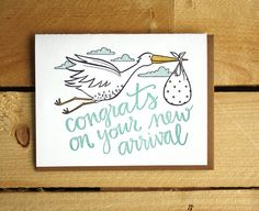 Congrats on your new arrival! Letterpress Card  Hand-drawn and letterpressed card with envelope.    • 4.25 x 5.5 inches  • Blank Inside  • Kraft paper