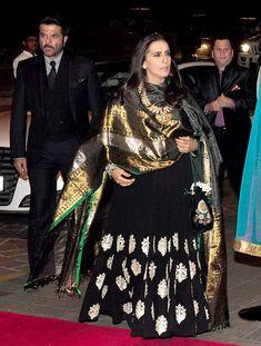 Anil Kapoor with wife Sunita at Arpita Khan's wedding reception in Mumbai. Kurta Designs Women, Blouse Designs, Indian Designer Outfits, Designer Dresses, Indian Dresses, Indian Outfits, Indian Wedding Guest Dress, Velvet Dress Designs, Mom Dress