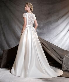 OTELO - Majestic mikado wedding dress with a bateau neckline and fitted waist. A new twist to the princess dress with flattering lace sleeves and side pockets. Bridal Gowns, Wedding Gowns, Lace Wedding, Pronovias Wedding Dress, Beautiful Gowns, Bridal Collection, Designer Dresses, Nice Dresses, Marie