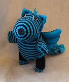 Positively awesome plush dragon made out of socks!!!  I plan to make one for my nephew...and one for myself!