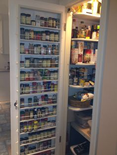 white wooden pantry kitchen cabinet door with full length spice shelves. white wooden pantry kitchen cabinet door with full length spice shelves. Spice Rack Pantry, Door Spice Rack, Pantry Door Storage, Wood Storage Rack, Spice Shelf, Spice Storage, Kitchen Organization Pantry, Kitchen Pantry, Spice Racks