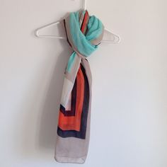 Long Scarf Colors are orange, Aqua, brown, black, and cream. 100% polyester. Worn few times. No rips, stain or holes. Long and wide. Lightweight Accessories Scarves & Wraps