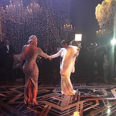 "Kris Jenner & Khloe Kardashian from Kris Jenner's Great Gatsby-Themed 60th Birthday Party  ""First dance!!! @khloekardashian #family #greatgatsby #bestbirthdayever,"" Kris wrote on her Instagram page.Khloe is wearing a $16,500 silver net beaded Yousef Al-Jasmi gown, also covered with more than 400,000 crystals, paired with a matching cap."