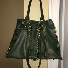 Brand new hobo handbag This is brand new, it's never been used or had a thing put in it. Tons of space and pockets and the cutest charms and strappy accents and chains. Bags Hobos