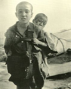 The damage of atomic bomb which Japanese Nagasaki received.   Brother wandering aimlessly. 10 August 1945.