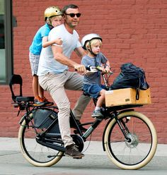 Liev Schreiber transported son Samuel and Sasha to school via bike in NYC Sept. 11.
