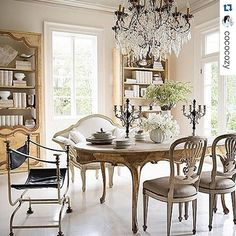 Chandeliers and antique pieces make this dining room absolutely stunning! @tarashawdesign custom collection on @onekingslane