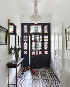 As much as we love period properties, their long narrow entrance halls can be a little underwhelming. Try adding oversized lighting to take advantage of the height and draws the eye upwards, including a statement runner or patterned tiles also creates interest and leads the eye through drawing your attention away from the narrowness. Painting the inside of the front door in a dark colour has the same effect from the inside as a dark colour brings the door 'towards' you visually making it… Back Door Entrance, House Entrance, Entrance Halls, Luxury Estate, Luxury Homes, Inside Front Doors, Hall Lighting, Front Door Colors, House Painting