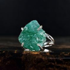 Raw, Uncut Genuine Emerald Ring V I D E O __________________________________________ https://youtu.be/CLO5YFUtK4s D E S C R I P T I O N __________________________________________ This Rustic Emerald ring is stunning with beautiful, vivid green color and gorgeous shimmering sparkle. Elegantly set in a 925 Sterling Silver clawband to fully accentuate the beauty of the stone and the setting together on any finger. Every Uncut Emerald is truly unique and one-of-a-kind-- no one els...