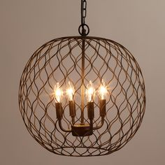 Crafted of iron with a dark bronze finish, our exclusive open globe chandelier adds a rustic-chic design element to your decor - it is the perfect lighting solution above a farmhouse dining table. >> #WorldMarket Home Decor, Lighting