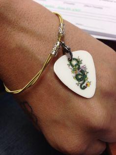 My guitar pick and guitar string bracelet.