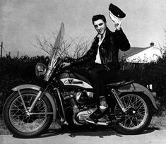 Elvis Presley aboard his red & white 1956 Harley-Davidson KH Model. The next year he bought a black '57 Harley-Davidson
