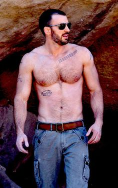 """Wanna know what's especially spectacular about these shots of a shirtless Chris Evans ( via )? I mean besides the whole """"shirtless Chris E. Christopher Evans, Chris Evans Captain America, Captain America Tattoo, Film D'action, Chris Evans Funny, Chris Evans Beard, Details Magazine, Robert Evans, Hommes Sexy"""