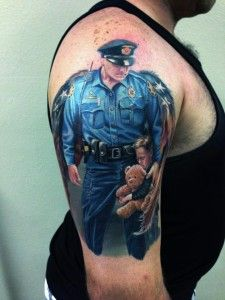 Really cool police officer #tattoo, this ranks #6 on our Top Ten List, check out the full list at www.mycooltattoos.net