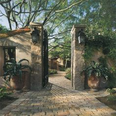 reclaimed brick pavers used for pathway to Spanish stone home