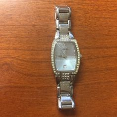 Silver and rhinestone fossil watch Beveled glass without scratches, has date and second hand. This watch us petite. Face is a pale silver blue. Gentle signs of wear to the band. Fossil Accessories Watches