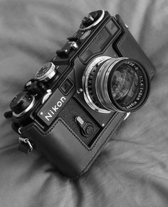 freehamburgers:    camera-porn:    Nikon SP, all dressed up.    such a sexy rangefinder. nikon, make again. dafuq were you thinking with the nikon 1 system?