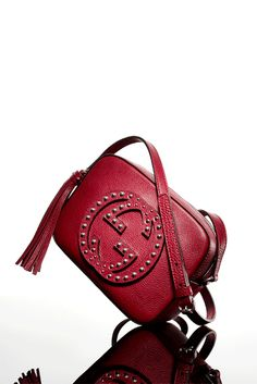 "Gucci ""Soho"" bag in leather with stud detail and detachable leather tassel."
