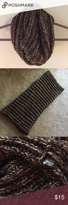 Boutique hand-knit infinity scarf in brown and tan Chocolate brown with tan accent fall/winter infinity scarf is hand-knit for a local boutique (so no tags other than fabric description). 100% acrylic and incredibly soft and comfortable! OS but has a ton of stretch. Received as a gift but it didn't match any of my winter coats 🙁 so it needs a good home! Boutique Accessories Scarves & Wraps